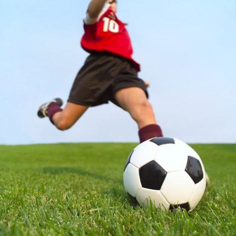Young athlete preparing to strike the soccer ball.